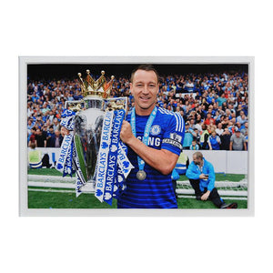 Close up image of John Terry holding the Premier League trophy