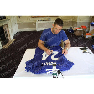 Gary Cahill Signed Shirt, signing the back of a chelsea shirt