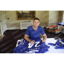 Load image into Gallery viewer, Gary Cahill hand signing a Chelsea FC shirt