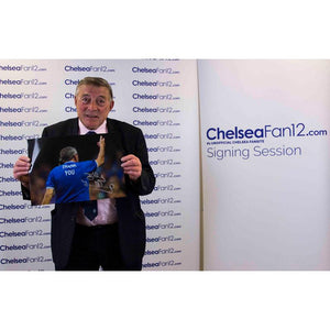 Bobby Tambling holding up his signed 'Welcome Home' photo
