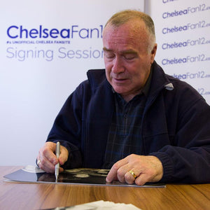 Ron 'Chopper' Harris signing a photo from the 1970 FA Cup win