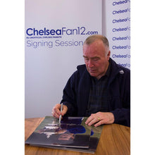 Load image into Gallery viewer, Ron Harris signing a photograph of him holding up the FA Cup