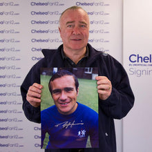 Load image into Gallery viewer, Ron Harris holding a Chelsea FC Photo from 1970, which he signed during a private signing session with ChelseaFan12