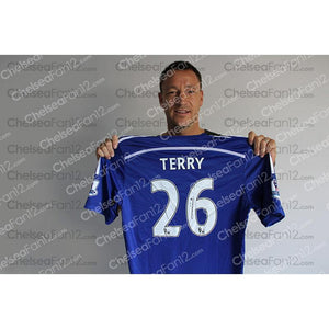 John Terry holding a Chelsea Shirt, during an exclusive signing session