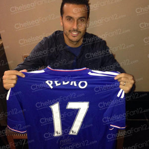 Pedro holding up Chelsea shirt