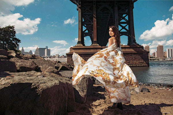 Gabby Westbrook models a Grecian inspired Chanel dress from their 2018 resort collection