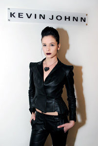 Lenka Marie modelling a form-fitting, tailored leather Stealth jacket and pant combo by fashion genius Kevin Johnn accented with Bunny Paige 'Xirius' Spiked and Paved Heart Necklace in Hematite!