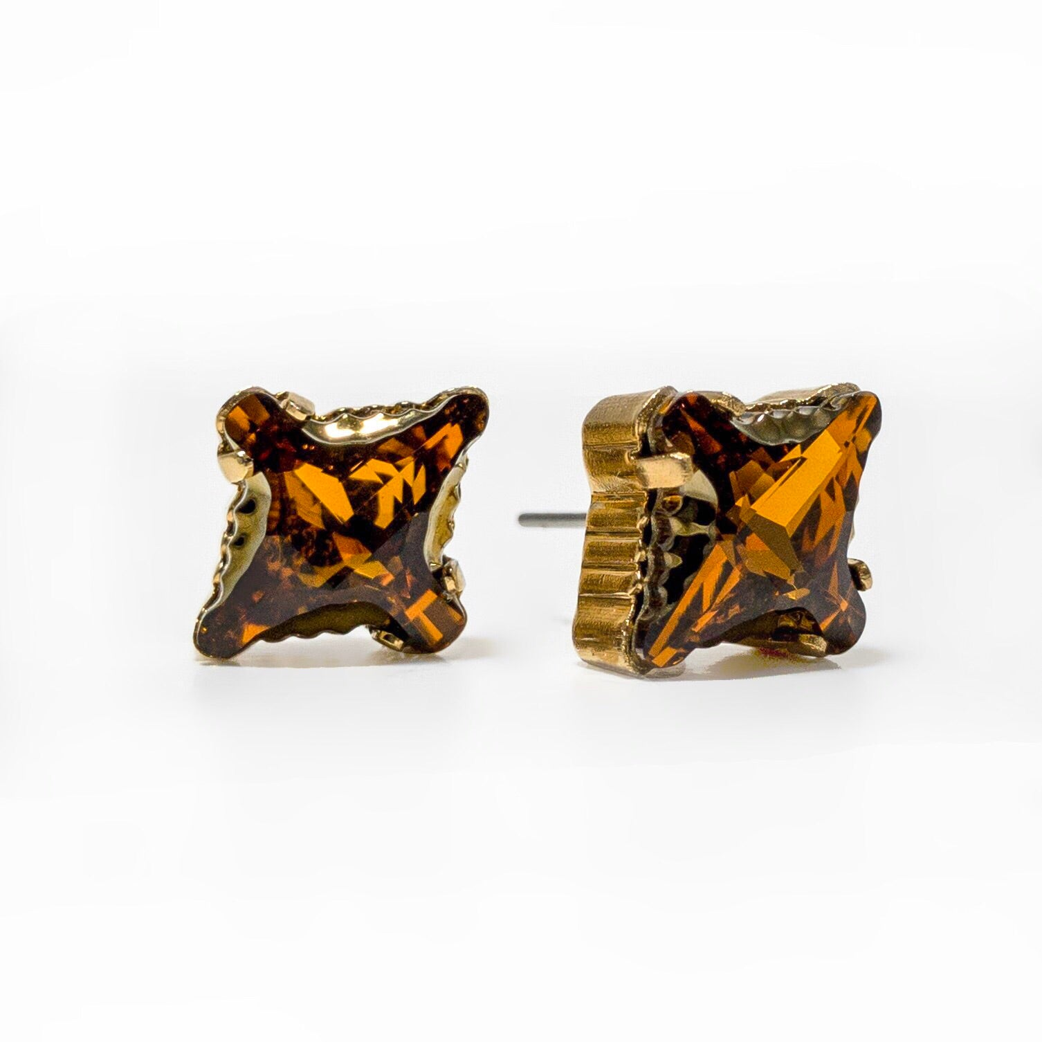 Multilayered cut, molded parts, and coated cavities create depth and texture in rhombus tribe crystal stud earrings.