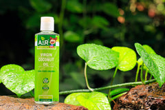 Air Thai Life Virgin Coconut Oil. Photo of product bottle taken in the beautiful Thailand jungle.