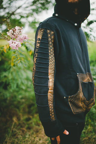 side view of our mens black zip front festival hoodie with  golden sacred geometry print