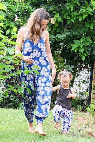 low crotch harem pants onesie jumpsuit by buddha pants - blue sunshine print