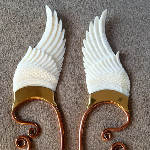 close up of bone wings clip on to become elven ears for fairy costume