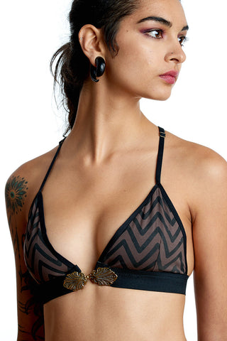 this striking bikini top with chevron print that will turn head on the festival dance floor.