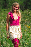 the womens mini bohemian style corset vest laces up the front and has a wide collar in organic cotton