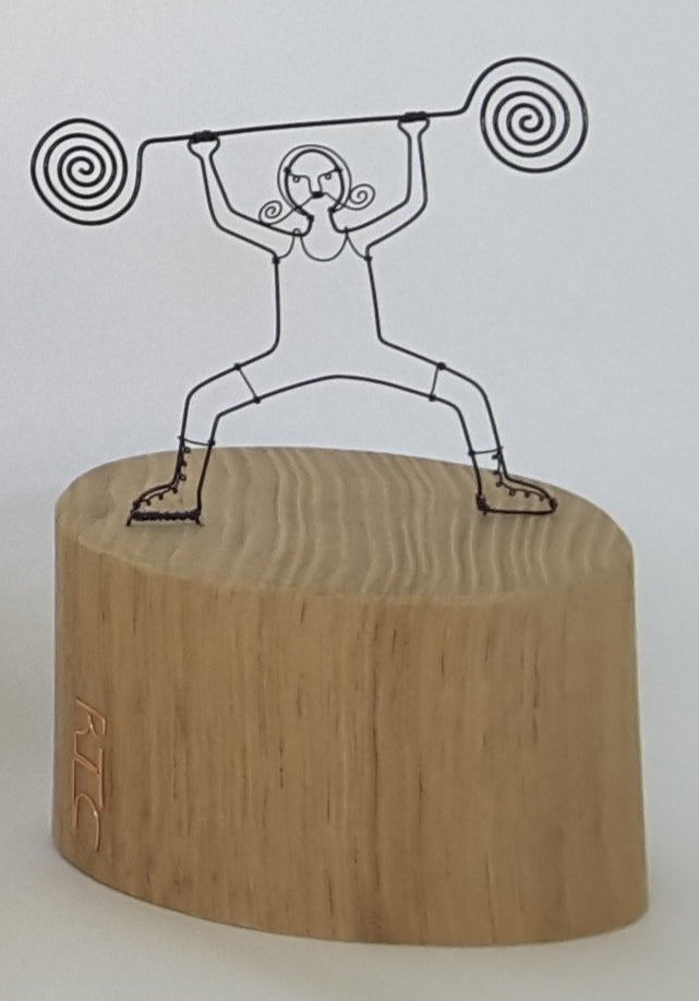 small strongman wire and wood sculpture by rebecca crawford