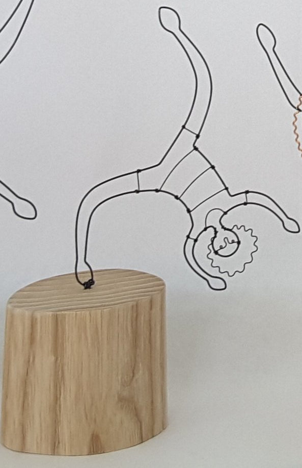 small acrobat on wooden block wire and wood sculpture by becky crawford