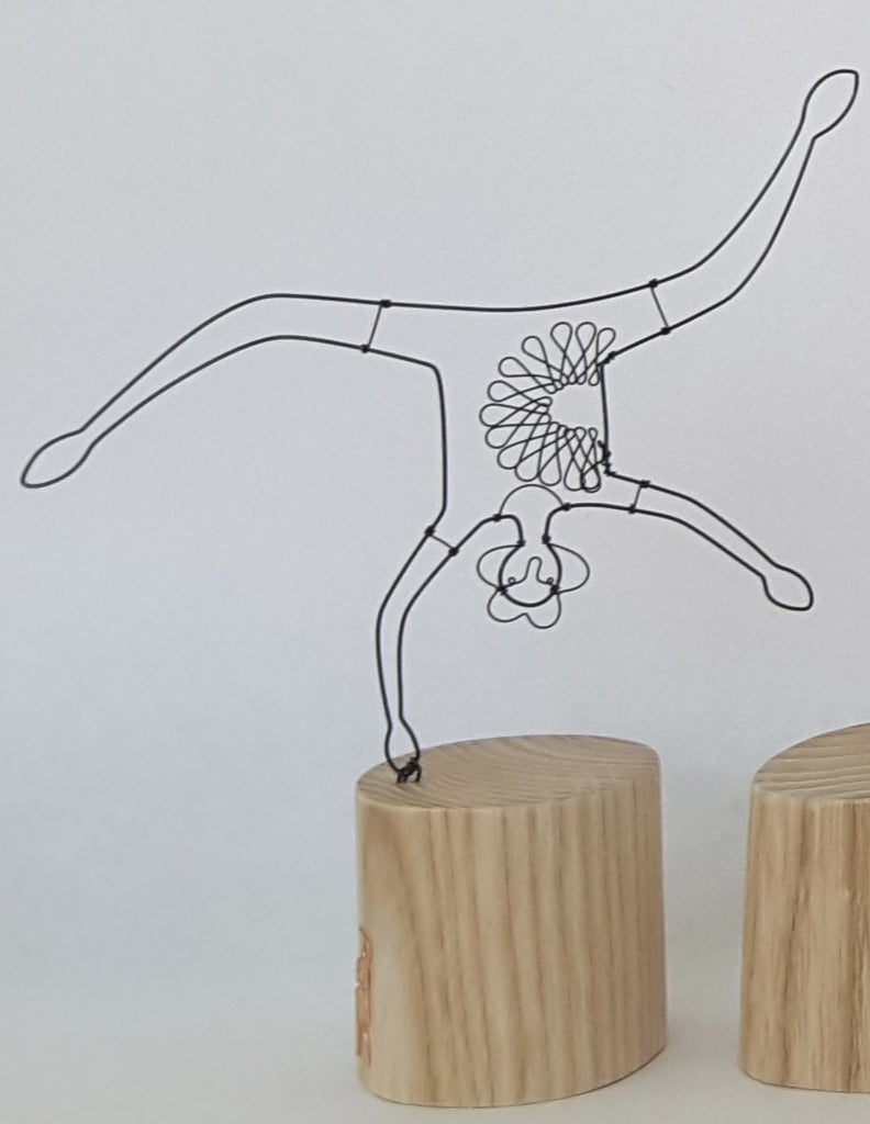 small handstand on wooden block wire and wood sculpture by beky crawford