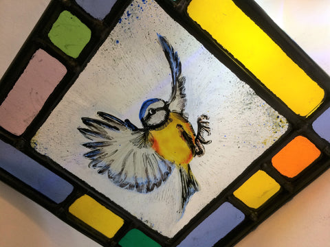 Bluetit, coloured border, stained glass by Bryan Smith