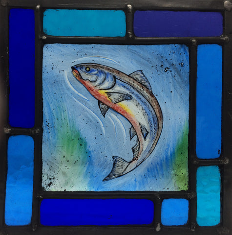 Salmon in multi-blue frame, stained glass by Bryan Smith