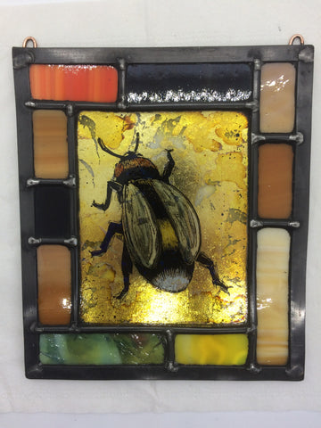 Bee in border of brown, gilded, stained glass by Bryan Smith