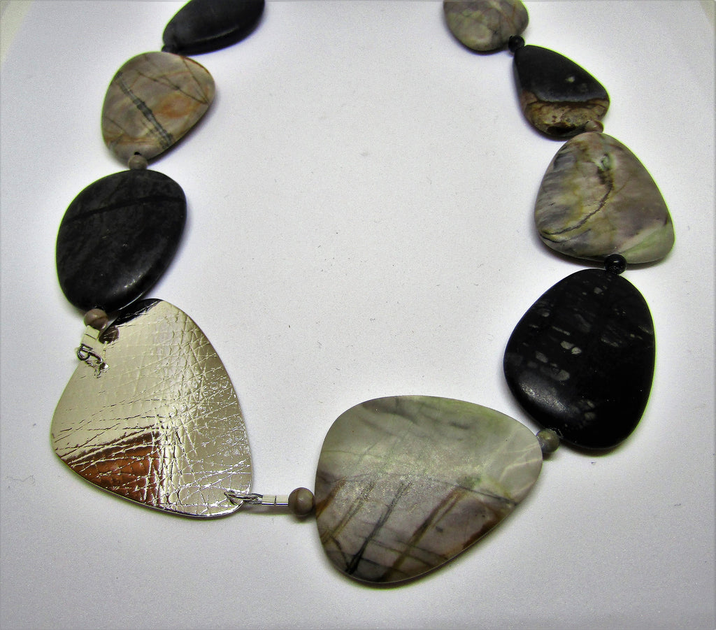 Stunning triangle necklace with picasso jasper. Hand-crafted by studio jeweller Angela Learoyd.