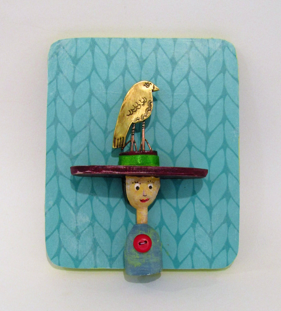 Lady in Large Hat with Bird