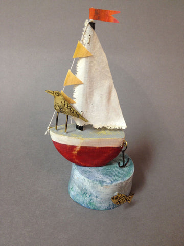 Red Sail Boat with Tern