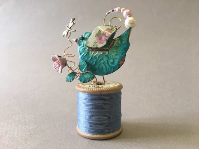 Small Bird on Blue Cotton Reel by Linda Lovatt
