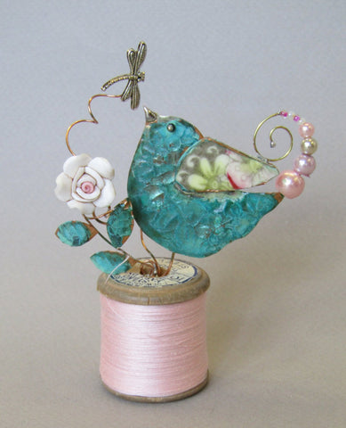 Small Bird Assemblage on a Cotton Reel