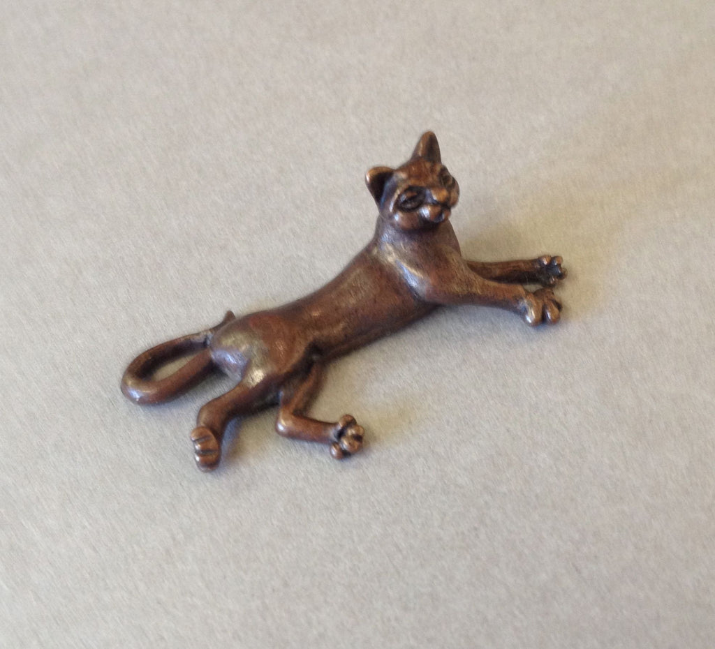 Miniature Lying Cat by David Meredith