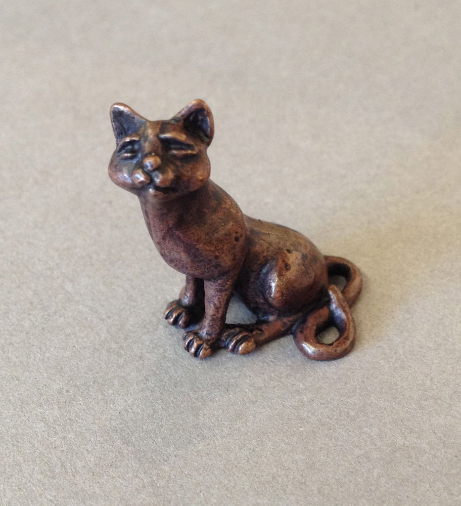 Miniature Sitting Cat by David Meredith
