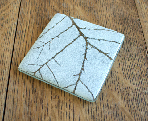 Glass Coaster. White with Plant Silhouettes by Verity Pulford