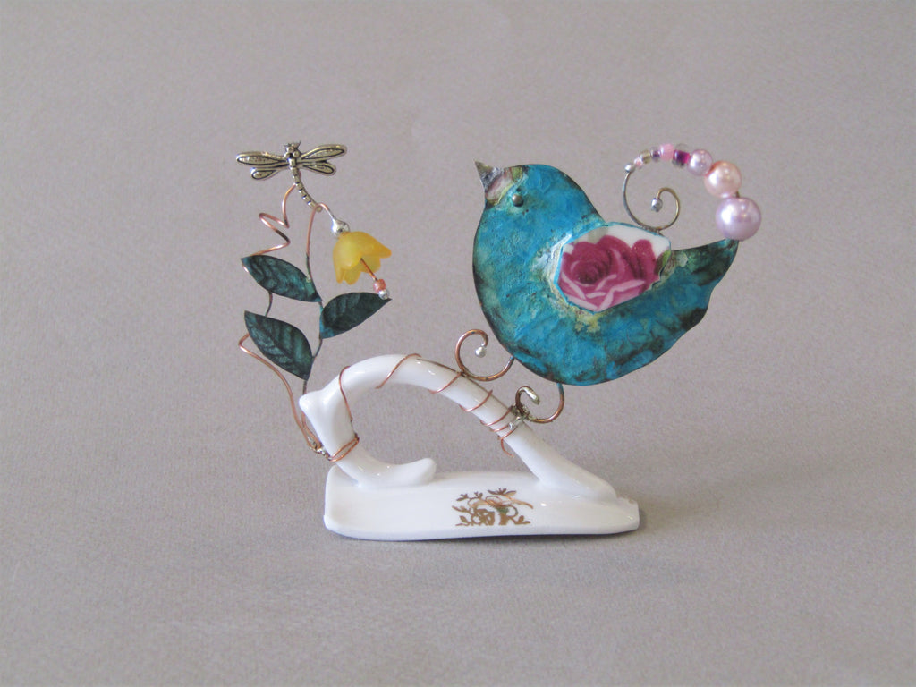 Small Birdie on Cup Handle with Yellow Flower by Linda Lovatt