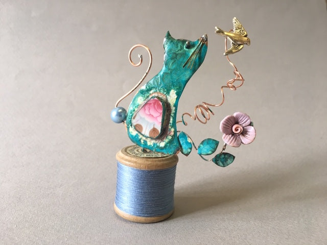 Small Cat on a Blue Bobbin by Linda Lovatt
