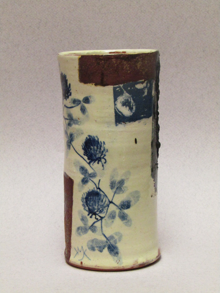 Blue and White Ceramic Cylinder by Mary Johnson.