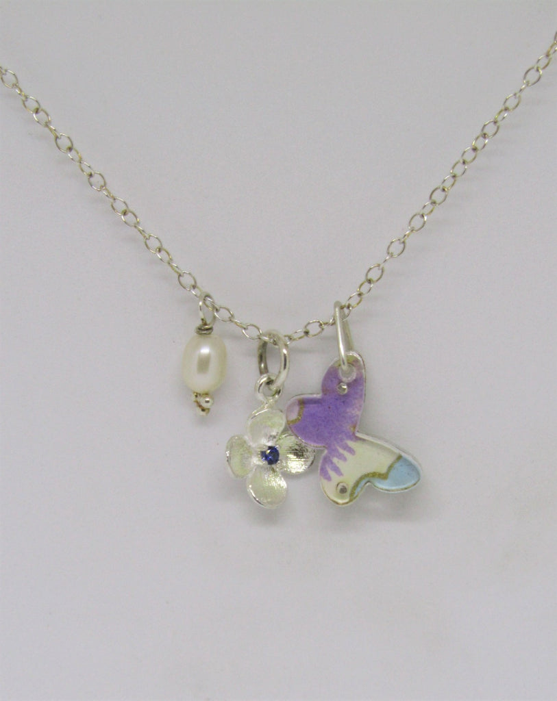 Butterfly, Flower and Pearl Charm Necklace by Sophie Court.