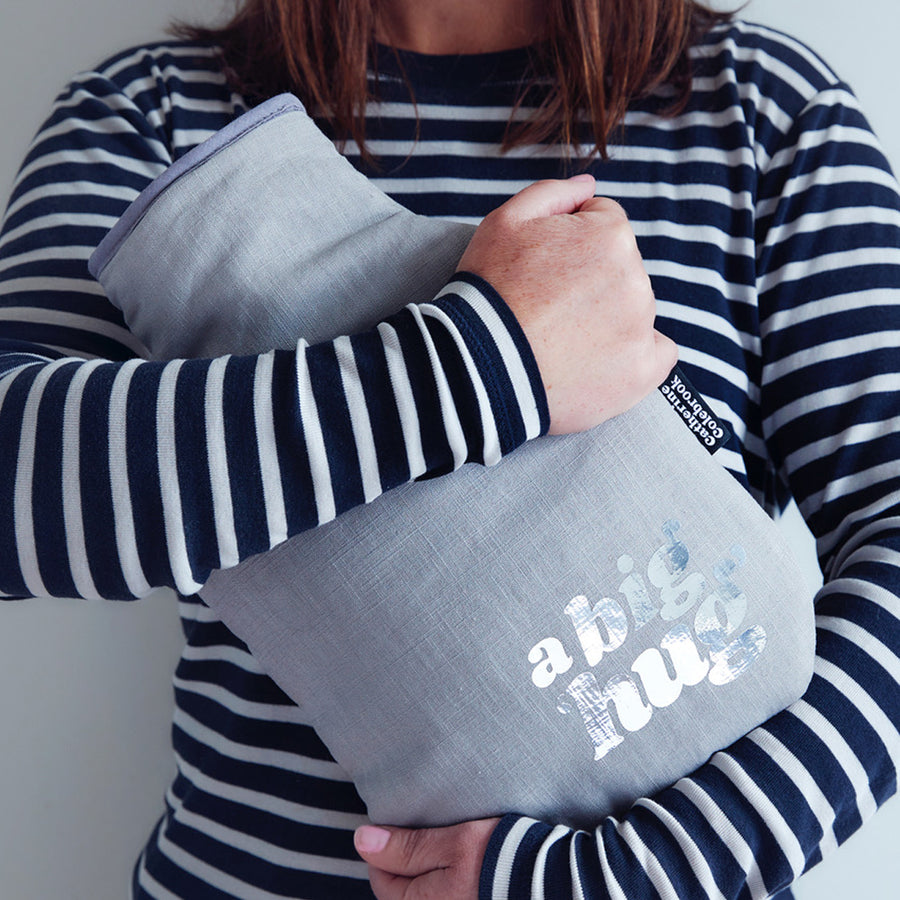 A BIG 'HUG' HOT WATER BOTTLE