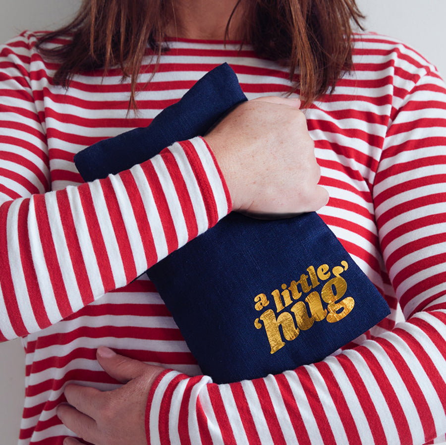 A LITTLE 'HUG' HOT WATER BOTTLE
