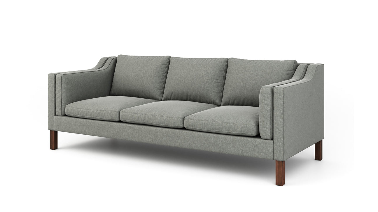 plush sofa with sloping arms