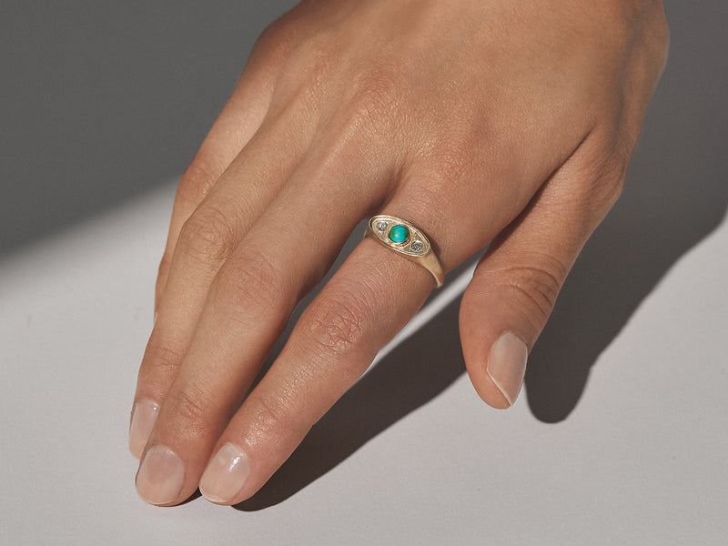 Model wears Shadow Ring in 14k Yellow Gold with Turquoise