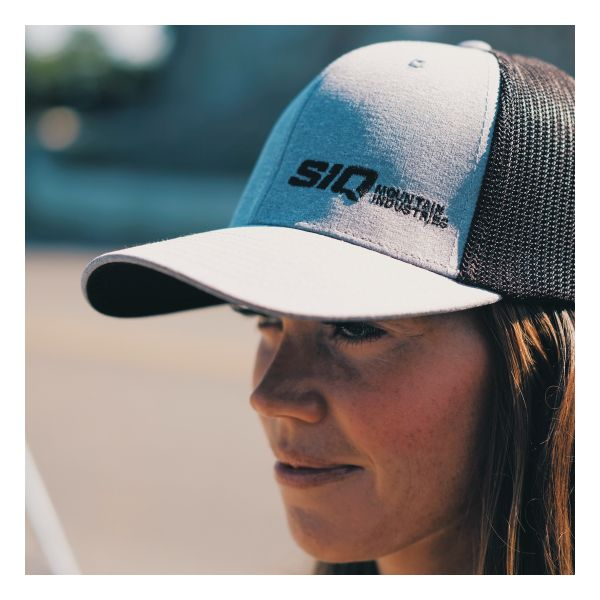 Woman wearing a SiQ Mountain Industries grey mesh back hat