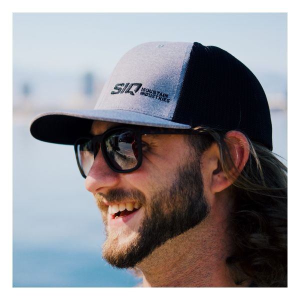 Man wearing a SiQ Mountain Industries grey mesh back hat