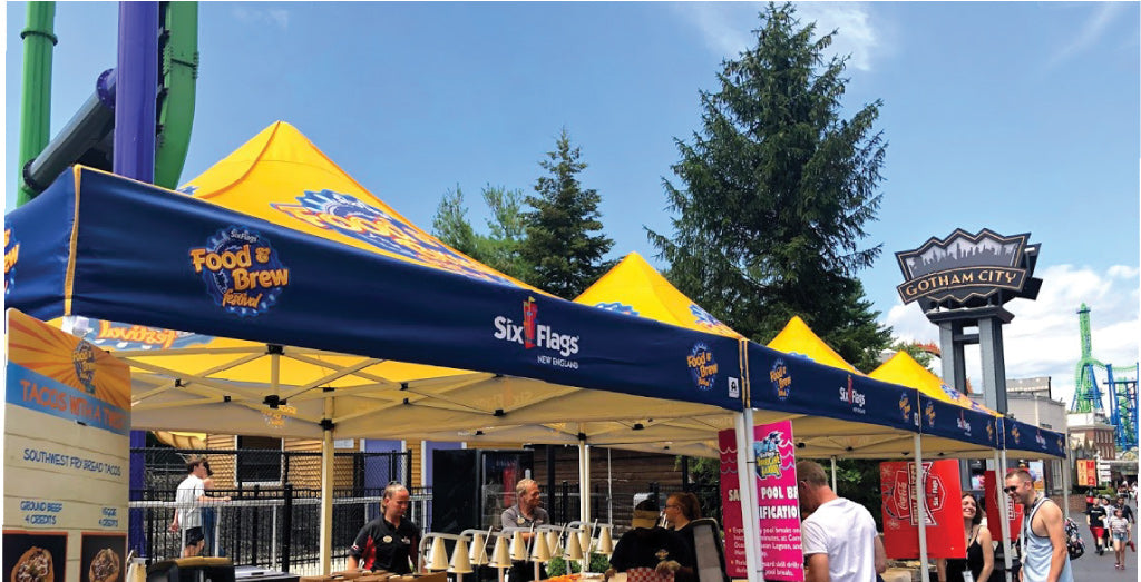 Six Flags festival's yellow peaks ensured that the organizer's brand and messaging was not overwhelmed by the participating vendors