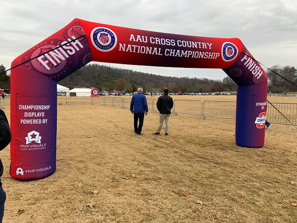 Angled arch production used as a finish line for cross country. Change the graphics to suit your brand or event