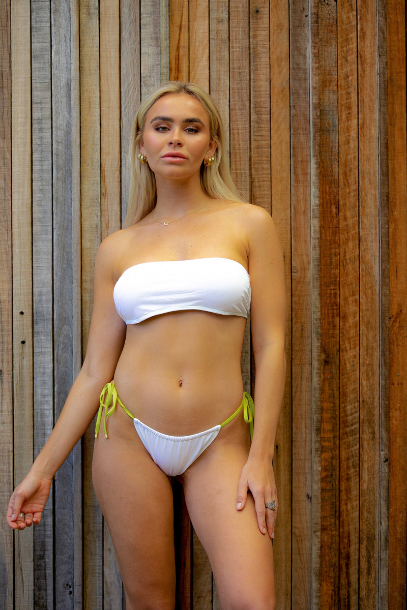White drawstring bikini bottoms with zingy lime ties and gold toggles. Made using sustainable and eco-friendly fabric - Amni Soul Eco®.