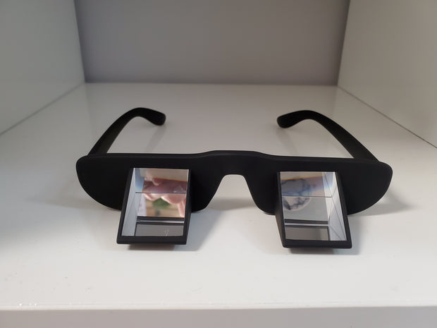 FACE DOWN POSITIONING GLASSES
