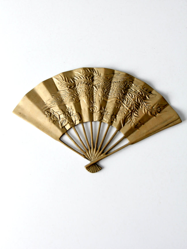 mid-century figurative brass fan wall hanging