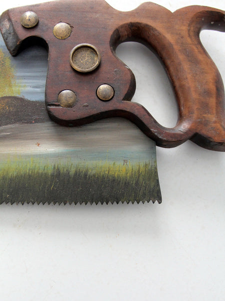 vintage folk art painting on Atkins hand saw