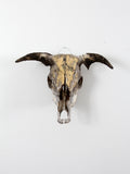 vintage bull skull with artwork