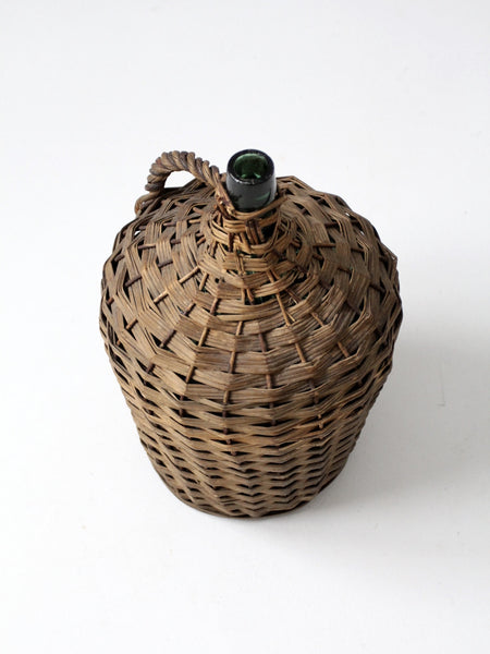 vintage demijohn with basket casing